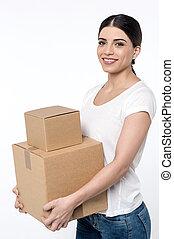 Woman holding couple of carton boxes