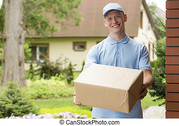 I have got your delivery - Shot of a young smiled delivery ...