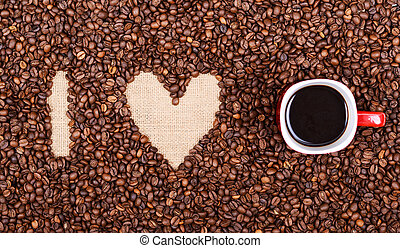 """""""I LOVE COFFEE"""" made of coffee beans and red coffee cup"""