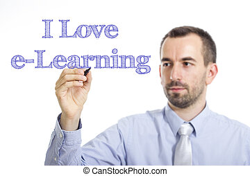 I Love e-Learning - Young businessman writing blue text on transparent surface