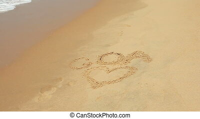 I love Goa - Waves touch sand with the inscription I love...
