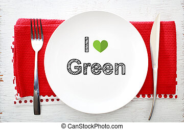 I love Green concept on white plate with fork and knife