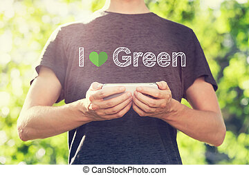I Love Green concept with young man holding his smartphone