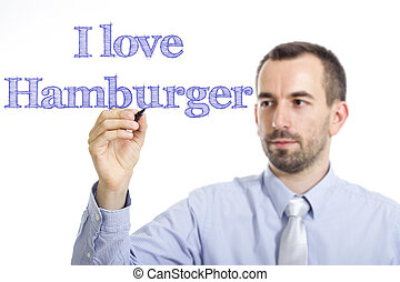 I love Hamburger - Young businessman writing blue text on transparent surface
