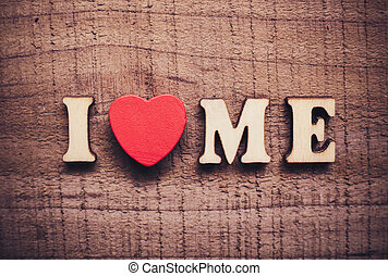 I Love Me with rustic wooden background.