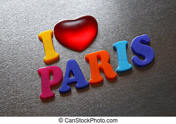 i love paris spelled out using colored fridge magnets