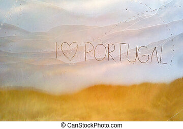 I love Portugal written in the sand at the beach