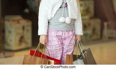 I love shopping. Little girl in the