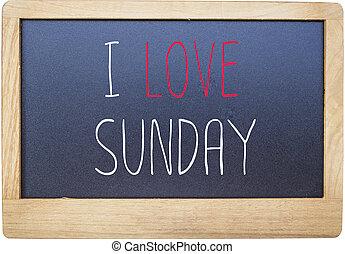 I love Sunday on Blank blackboard isolated on white background.