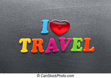 i love travel spelled out using colored fridge magnets