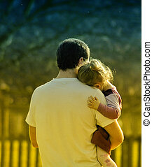 Bonding between father and daughter during a walk in the park