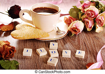 I love you made of scrabble letters ,dried roses ,cup of...