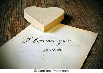 I love you, mom written on an old sheet of paper, with a retro e
