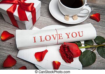 """i love you"" newspaper, cup of coffee"