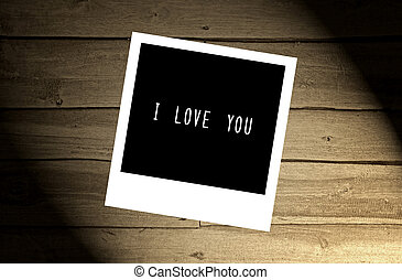 I love you note on brown wooden wall