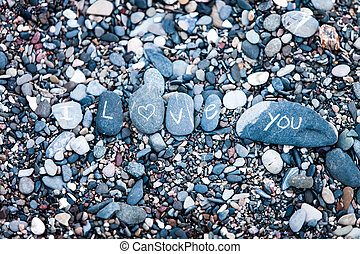 I Love You note on rocks