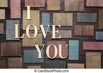 I love you - Wooden letters forming words I LOVE YOU written...