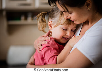 I love you - Mother and daughter embracing indoors at home