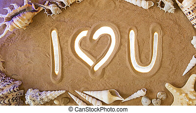 I Love You symbol in the sand. Beach background. Top view -...