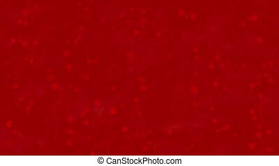 """""""I Love You"""" text formed from dust and turns to dust horizontally on red background"""