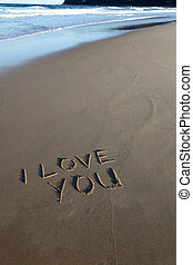 I love you written in the sand at the beach