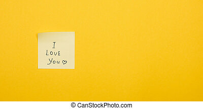 i love you. yellow sticky note on yellow background with copy space