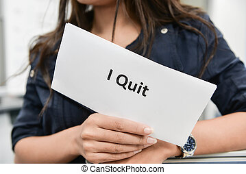 I Quit - Business woman is showing the document for resignation for quit the job
