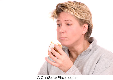 I really should not be eating this... - Mature blond woman ...