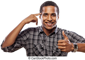smiling dark-skinned young man showing thumbs up and touching his head with his finger