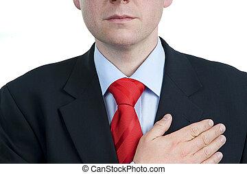I swear - Mid aged man keeping hand on heart - Man keeping...