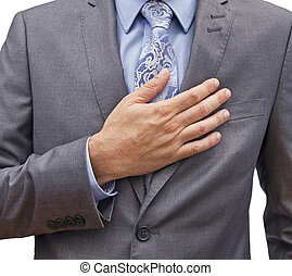 i swear - closeup of a man in a suit with his hand over his...