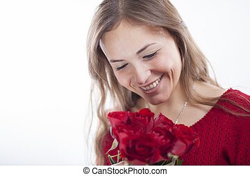 Gorgeous young woman in red with a bouquet of red roses
