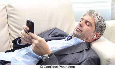 I think I?ll fall asleep - A young handsome businessman...