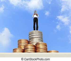 Successful business man working and using digital tablet pc on growth money stairs coin with sky