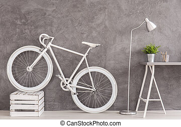 I want to ride my bike... - Grey interior with white bike,...