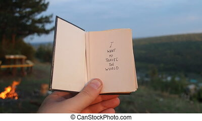 I want to see the World. Book with the inscription. Travel idea.