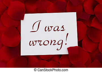 I was wrong card, A white card with text I was wrong and a red rose pedal backgrounds