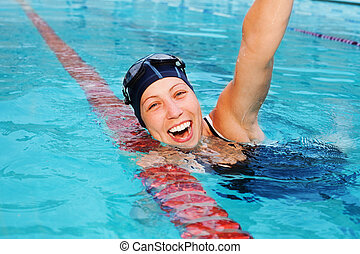 nice girl professional swimmer is happy she won swimming contest