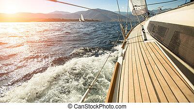 iate, velejando, direção, a, sunset., sailing., luxo, yachts.