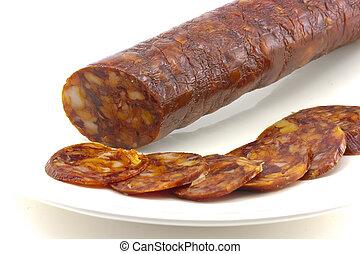 Iberian chorizo??, tasty sausage on plate, and sliced