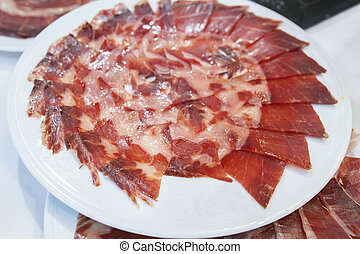 Iberian cured ham with empty space on plate to put a brand