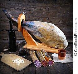 Iberian ham. - Iberian ham and Spanish sausages on wooden...