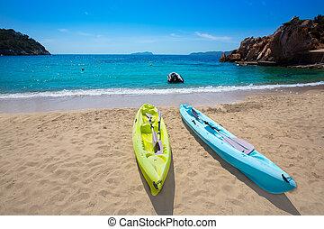 Ibiza cala Sant Vicent beach with Kayaks san Juan at Balearic Islands of spain