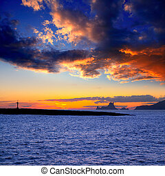 Ibiza island sunset with Es Vedra in background and Gastabi islet of Formentera