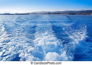 Ibiza San Antonio Abad from boat wake in blue mediterranean