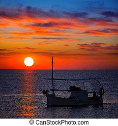 Ibiza sunset  view and fisherboat formentera