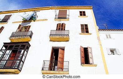 Ibiza town white facades of mediterranean village in Balearic