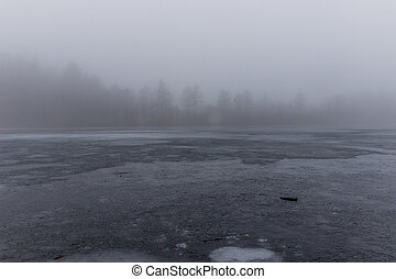 Ice and mist and a frozen lake
