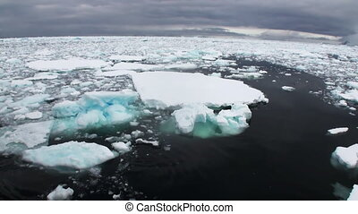 Ice and small icebergs floats on ocean surface. - Ice and ...