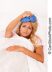 Ice bag for headaches and migraines - Woman with ice bag for...
